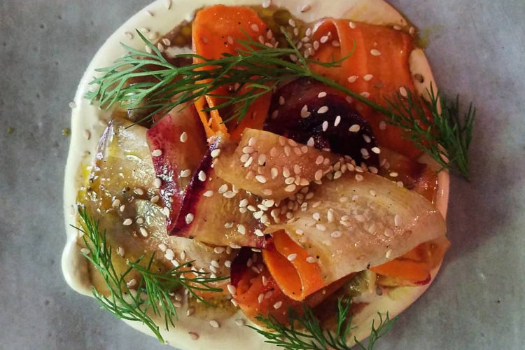Tangle of Heirloom Carrots in a Pomegranate Molasses Vinaigrette atop Tangy Sour Cream, Garnished with Dill & Sesame Seeds